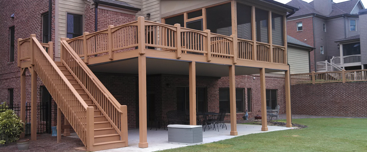 build an under deck patio that has an expertly designed under deck drainage system and use - Patio Under Deck